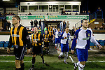16.09.2008 Leek, England. The players of Leek Town (blue) and Clitheroe walking onto the pitch prior to the clubs FA Cup 1st Qualifying Round replay at Harrison Park, Leek. The first match ended in a one-all draw but it was Clitheroe who progressed to the next round winning the replay one-nil, despite having a man sent off in the second half. The preliminary stages of the FA Cup were used to determine which non-League clubs were included in the first round proper of the FA Cup. Photo by Colin McPherson.