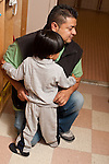 Education preschool 2-3 year olds reluctant boy holds onto father before separation