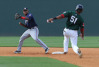 Infielder Elmer Reyes (7) of the Rome Braves turns the first part of a double play, putting out Henry Ramos (51) of the Greenville Drive in a game on May 6, 2012, at Fluor Field at the West End in Greenville, South Carolina. Greenville won, 11-3. (Tom Priddy/Four Seam Images).2B