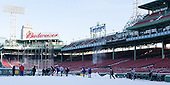 The Providence Friars head out to the ice from the Red Sox home dugout. -  - The participating teams in Hockey East's first doubleheader during Frozen Fenway practiced on January 3, 2014 at Fenway Park in Boston, Massachusetts.