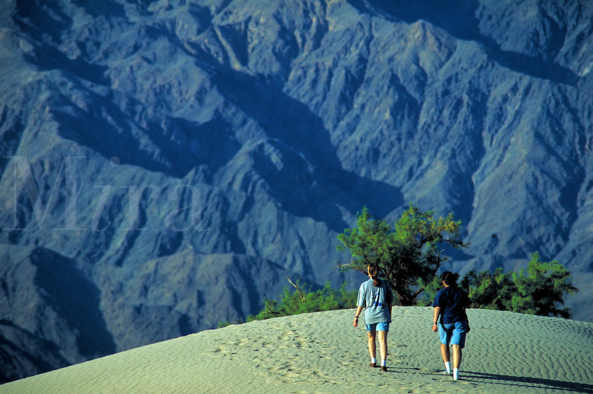 Tourists hiking on sand dunes at the Death Valley National Monument, California. Desert, Environment, National Parks,. California USA Death Valley.