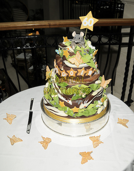 CHRISTOPHER BIGGINS' CAKE.The cake cutting photocall to celebrate his 60th birthday, Landmark Hotel, Marylebone Road, London, England..December 15th, 2008. cake tiered layers layerd star mouse icing table gv general view atmosphere .CAP/CAN.©Can Nguyen/Capital Pictures.