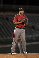 AZL Diamondbacks relief pitcher Ezequiel De La Cruz (14) checks a runner at first base during an Arizona League game against the AZL Cubs 1 at Sloan Park on June 18, 2018 in Mesa, Arizona. AZL Diamondbacks defeated AZL Cubs 1 7-0. (Zachary Lucy/Four Seam Images)