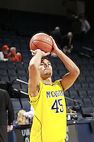 CHARLOTTESVILLE, VA- NOVEMBER 29: Colton Christian #45 of the Michigan Wolverines during the game on November 29, 2011 at the John Paul Jones Arena in Charlottesville, Virginia. Virginia defeated Michigan 70-58. (Photo by Andrew Shurtleff/Getty Images) *** Local Caption *** Colton Christian