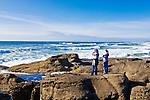 """Tourists at viewpoint on Yachts Beach, Yachats, Oregon.  Yachats is a coastal city in Lincoln County, Oregon.  The name is derived from the Native American Siletz word for """"Foot of the Mountain"""".  Yachats State Recreation Area 804 Trail."""