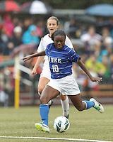 Duke University midfielder Toni Payne (10) takes a shot. Boston College (white) defeated Duke University (blue/white), 4-1, at Newton Campus Field, on October 6, 2013.