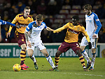 Motherwell v St Johnstone…06.02.18…  Fir Park…  SPFL<br />Jason Kerr and Gael Bigirimana<br />Picture by Graeme Hart. <br />Copyright Perthshire Picture Agency<br />Tel: 01738 623350  Mobile: 07990 594431