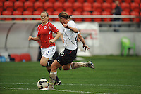 Abby Wambach strikes her first of two goals. The USA defeated Norway 2-1 at Olhao Stadium on February 26, 2010 at the Algarve Cup.
