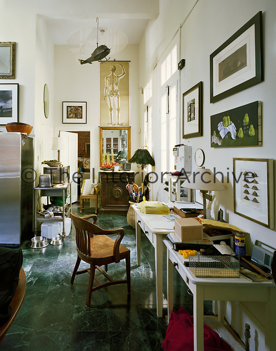 A multi-functional cormer of the kitchen in a Victorian New Orleans home. A working from home desk sits happily (some may say conveniently) alongside a Dualit toaster and microwave. A model helicopter suspended from the ceiling mixed with a skeletal diagram add to the eclectic mix.