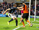 Dundee Utd's Nadir Ciftci gets a grip of Dundee's James McPake.