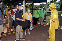 Savannah Bananas owner Jesse Cole (right) talks with fans before a Collegiate Summer League game  against the Macon Bacon on July 15, 2020 at Grayson Stadium in Savannah, Georgia.  (Mike Janes/Four Seam Images)