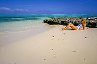 sunbather on beach at Lac Bay, Bonaire Netherland Antilles or Dutch ABC Islands (Caribbean Sea, Atlantic)