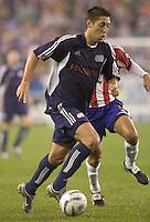 Clint Dempsey moves past a Chivas defender. New England Revolution defeat CD Chivas USA, 1-0 at Gillette Stadium on April 30, 2005.