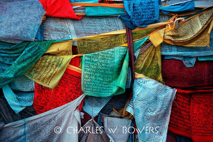 Grouping of Tibetan prayer flags. Prayer flags dominate the terrain of Tibet.
