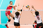Opposite spiker Xiangyu Gong of China (L) spikes the ball during the FIVB Volleyball World Grand Prix match between China vs Japan on July 21, 2017 in Hong Kong, China. Photo by Marcio Rodrigo Machado / Power Sport Images