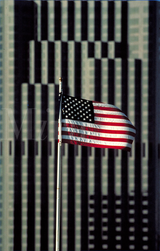 Tall office tower and American flag. US flag, old glory, building, industry, power. San Francisco California USA.