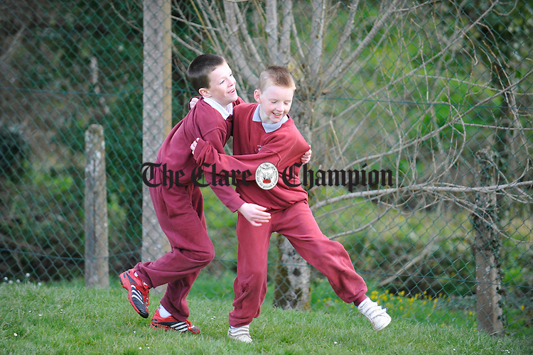 Oisin Hennessy and Mark Crowe celebrate a goal during sos break at Ballyea NS. Photograph by John Kelly.