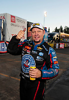 Nov 17, 2019; Pomona, CA, USA; NHRA funny car driver Robert Hight celebrates after clinching the 2019 funny car world championship during the Auto Club Finals at Auto Club Raceway at Pomona. Mandatory Credit: Mark J. Rebilas-USA TODAY Sports