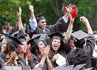University of Virginia Students in the College of Arts and Sciences cheer as their degrees are conferred during Final Exercises on Sunday May 22 2005 in Charlottesville. graduate celebrate happy