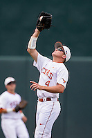 Texas Longhorns outfielder Collin Shaw (4) makes a catch during the NCAA Super Regional baseball game against the Houston Cougars on June 7, 2014 at UFCU Disch–Falk Field in Austin, Texas. The Longhorns are headed to the College World Series after they defeated the Cougars 4-0 in Game 2 of the NCAA Super Regional. (Andrew Woolley/Four Seam Images)