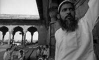 Delhi /  India.In the foreground the mullah of the madrasa near Jama Masjid, the principal mosque of Old Delhi in India..Photo Livio Senigalliesi.