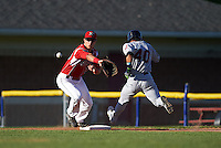 Batavia Muckdogs first baseman Eric Fisher (29) stretches for a throw as Ka'ai Tom (40) runs through the bag during a game against the Mahoning Valley Scrappers on June 23, 2015 at Dwyer Stadium in Batavia, New York.  Mahoning Valley defeated Batavia 11-2.  (Mike Janes/Four Seam Images)