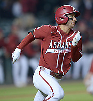 Arkansas second baseman Robert Moore heads to first Friday, April 2, 2021, after hitting a go-ahead, RBI single during the seventh inning of play against Auburn at Baum-Walker Stadium in Fayetteville. Visit nwaonline.com/210403Daily/ for today's photo gallery. <br /> (NWA Democrat-Gazette/Andy Shupe)