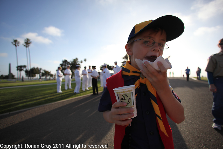 Fort Rosecrans National Cemetery, San Diego, CA.  May 28th, 2011:  Hundreds of Cubs, Boy Scouts, Girl Scouts and their parents spread out across the cemetery to plant flags on each grave for Memorial Day 2011.