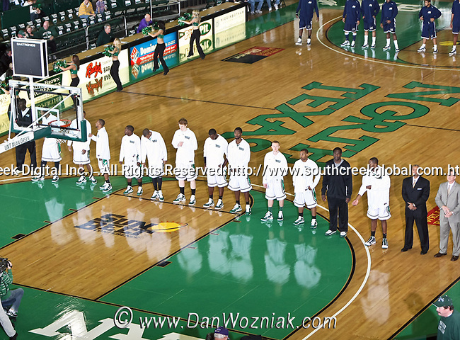 North Texas Mean Green line up before the game between the Jackson State Tigers and the University of North Texas Mean Green at the North Texas Coliseum,the Super Pit, in Denton, Texas. UNT defeated Jackson 68 to 49