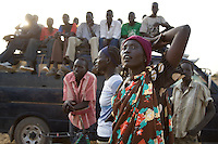 A young woman watches a volleyball match at the Twic Olympics in Wunrok, Southern Sudan.