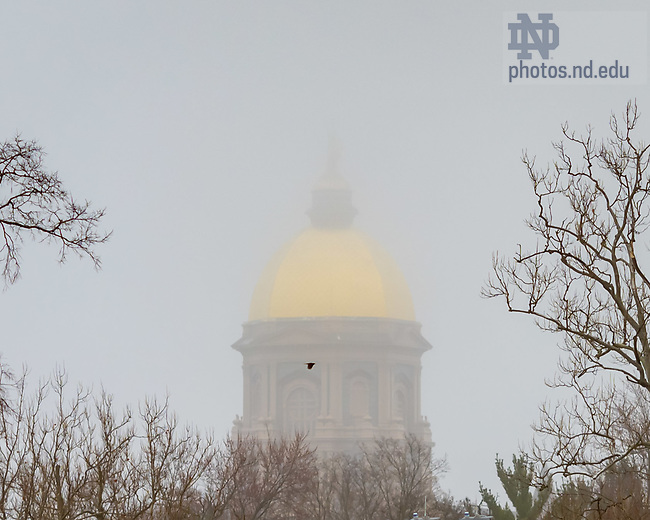 March 19, 2020; Main Building on a misty morning (Photo by Matt Cashore/University of Notre Dame)