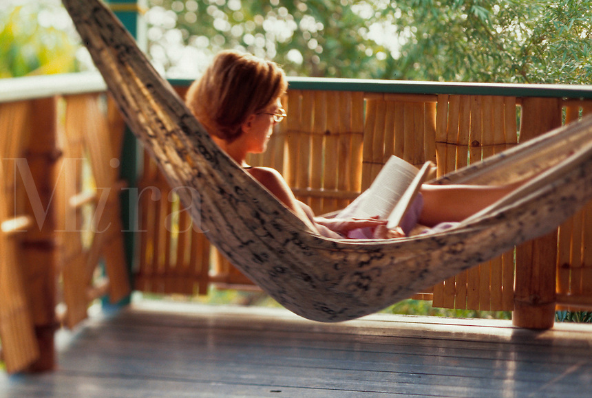 Woman reading in hammock.