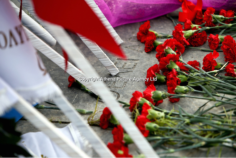 Pictured: Red carnations left at the monument for the uprising at the Athens Polytechinc in Athens Greece. Wednesday 16 November 2016<br /> Re: 43rd anniversary of the Athens Polytechnic uprising of 1973 which was a massive demonstration of popular rejection of the Greek military junta of 1967–1974. The uprising began on November 14, 1973, escalated to an open anti-junta revolt and ended in bloodshed in the early morning of November 17 after a series of events starting with a tank crashing through the gates of the Polytechnic.