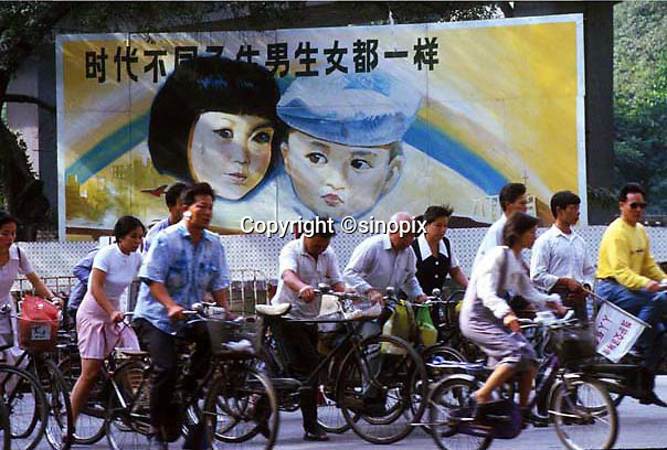 A  POSTER  IN GUANGZHOU SAYS THAT BOYS AND GIRLS ARE EQUAL IN CHINA.  THE ONE CHILD POLICY HAS RESULTED IN SOCIAL DISORDER AND AN UNNATURAL SKEW IN THE POPULATION. YOUNG BOYS ARE VALUABLE AND SOLD TO COUPLES IN THE RICH CITIES ESPECIALLY ON THE COAST WHILE GIRLS ARE OFTEN SOLD INTO PROSTITUTION RINGS AND AS BRIDES IN THE COUTRY-SIDE WHERE THE NUMBER OF BOYS OUTNUMBERS GIRLS BY AS MANY AS 150 TO 100. <br /> ©sinopix