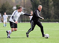 Thursday 11 April 2013<br /> Pictured: First team coach Alan Curtis (R) against South Wales Evening Post sports reporter Gareth Vincent (L)<br /> Re: Friendly game, Swansea City FC coaching staff v sports reporters at the Swansea City FC training ground. Final score 10-4.