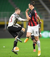 18th March 2021; San Siro stadium, Milan, Italy;  AC Milans Zlatan Ibrahimovic challenges with Manchester Uniteds Luke Shaw during the Europa League round of 16 second leg match between AC Milan and Manchester United in Milan, Italy