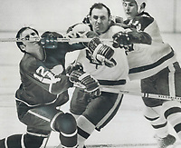 Didn't get caught: Leafs' Bobby Baun (centre) uses his stick to gently massage the nose of Vancouver's Mike Corrigan (12), Baun didn't get caught but Corrigan was given a misconduct by referee Bob Sloan for protesting the incident.