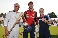 Olympic Hockey Bronze Medalist Chloe Rogers poses for a photograph with Essex skipper James Foster (C) and torch bearer Ken Edwards - Essex Eagles vs Netherlands - Clydesdale Bank 40 Cricket at Castle Park, Colchester - 19/08/12 - MANDATORY CREDIT: Gavin Ellis/TGSPHOTO - Self billing applies where appropriate - 0845 094 6026 - contact@tgsphoto.co.uk - NO UNPAID USE.