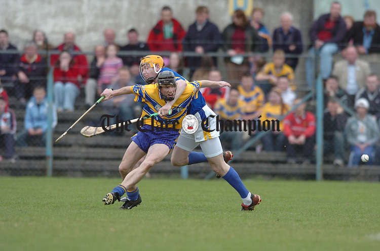 Lar Corbett of Tipperary gets to grips with Clare's Colm Fode furing the national league game in Cusack park. Phoograph by John Kelly.