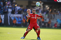 SAN JOSE, CA - FEBRUARY 29: Jackson Yueill #14 of the San Jose Earthquakes battles for the ball with Alejandro Pozuelo #10 of Toronto FC during a game between Toronto FC and San Jose Earthquakes at Earthquakes Stadium on February 29, 2020 in San Jose, California.