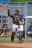 GCL Marlins catcher Pablo Garcia (5) signals one out during the first game of a doubleheader against the GCL Mets on July 24, 2015 at the St. Lucie Sports Complex in St. Lucie, Florida.  GCL Marlins defeated the GCL Mets 5-4.  (Mike Janes/Four Seam Images)