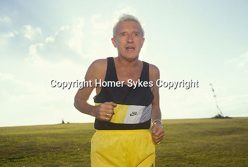 Jimmy Saville training in Roundhay Park, Leeds, Yorkshire, UK His apartment overlooked the park. 1980s