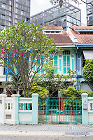 Singapore.  Emerald Hill Road Early Twentieth Century Chinese Houses in foreground, Modern Office Buildings in background.