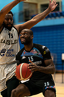 Tayo Ogedengbe of Surrey Scorchers under pressure from Darius Defoe of Newcastle Eagles during the BBL Championship match between Surrey Scorchers and Newcastle Eagles at Surrey Sports Park, Guildford, England on 20 March 2021. Photo by Liam McAvoy.