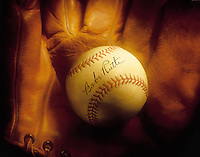 Nostalgic version of old baseball with Babe Ruth's signature, with glove. Houston Texas.