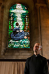 Rev. Thomas Wharton, Vicar of Romsey Abbey admires 'The Calling Window' by artist Sophie Hacker