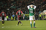 Hibs v St Johnstone....21.12.13    SPFL<br /> James Collins holds his head after not being awarded a penalty<br /> Picture by Graeme Hart.<br /> Copyright Perthshire Picture Agency<br /> Tel: 01738 623350  Mobile: 07990 594431