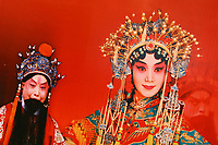 CHINA. Beijing. A poster of Peking Opera performers inside the Grand National Theatre. Designed by French architect Paul Andreu, The Grand National Theatre is located near Beijing's central Tian'anmen Square. It is an enormous glass and titanium tear-drop-like bubble structure surrounded by water. As China's top art performance center, it covers a total floor space of around 180,000 square meters, including 130,000 square meters for the main building and 50,000 square meters underground facilities. 2008.