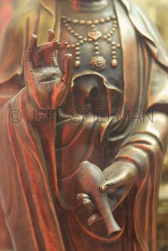 THIS IMAGE IS AVAILABLE EXCLUSIVELY FROM GETTY IMAGES.....Please search for image # 200535104-001 on www.gettyimages.com ....Detail of a Traditional Chinese Buddhist Religious Statue Displayed in the Window of a Store in New York City's Chinatown, New York, NY, USA