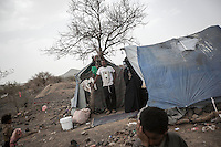 Thursday 09 July, 2015: A displaced family from the heavy fighting and bombardments in Haradh bordertown is seen in Darawan, a temporary settlement in the outskirts of Sana'a, the capital city of Yemen. (Photo/Narciso Contreras)